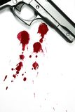 Lethal Weapon. Illustrative styled photograph of a hand gun and blood splatter, on a white background Stock Image