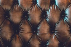 Lether background. Detail of brown lether sofa for vintage background Stock Photos