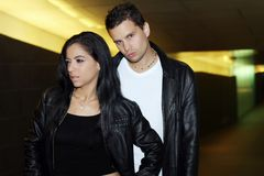 Lether Jacket photoshoot. Fashion couple wearing leather jacket royalty free stock image