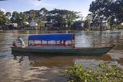 Leticia - region Amazonas - Colombia. Leticia - region Amazonas - Colombia, June 11, 2018: Small wooden canoes with an explosion engine called `peque peque` are Royalty Free Stock Photo