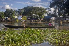 Leticia - region Amazonas - Colombia,. June 11, 2018: Small wooden canoes with an explosion engine called `peque peque` are the public transport that travel Stock Image