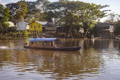 Leticia - region Amazonas - Colombia. Leticia - region Amazonas - Colombia, June 11, 2018: Small wooden canoes with an explosion engine called `peque peque` are Stock Photography