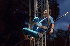 Letni Letna - XV. International Festival of New Circus and Theatre. Letna, Prague - July 15: Performer, the artist floats over the stage, tied with fabricduring Stock Image