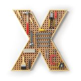 Letra X Alfabeto das ferramentas no pegboard do metal isoladas Foto de Stock