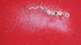 A letra branca telha mover-se para soletrar para fora o Natal no brilho video estoque