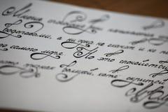 Letra caligráfica Fotos de archivo libres de regalías