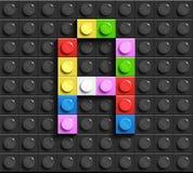 Letra colorida G dos tijolos do lego da construção no fundo preto do lego Letra M de Lego ilustração stock
