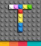 Letra colorida T de ladrillos del lego del edificio en fondo gris del lego Letra M de Lego stock de ilustración