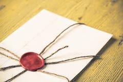 Letra com selo na tabela Imagem de Stock Royalty Free