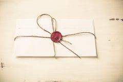 Letra com selo na tabela Fotos de Stock Royalty Free