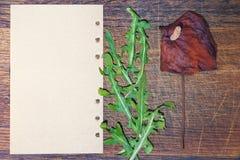 Letra con la flor secada Imágenes de archivo libres de regalías