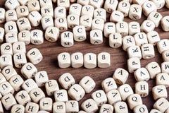 2018, letra corta palabra en cuadritos Imagen de archivo