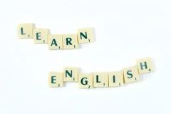 A letra da soletração do jogo de mesa aprende o inglês isolada no fundo branco Foto de Stock Royalty Free