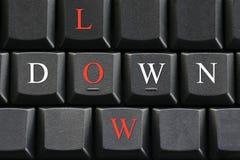 A letra de para baixo e baixo no fundo do teclado de computador Imagem de Stock