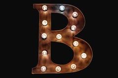 Letra decorativa con las bombillas foto de archivo libre de regalías