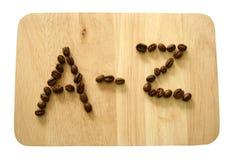 A letra dos feijões de café fotografia de stock
