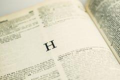 Letra H del primer en diccionario inglés Imagenes de archivo