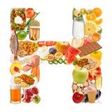 Letra H feita do alimento imagem de stock