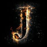 Letra J del fuego Imagenes de archivo