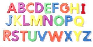 Letra magnética del alfabeto en el fondo blanco Fotografía de archivo libre de regalías