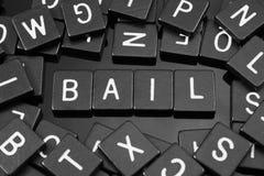 A letra preta telha a soletração da palavra & do x22; bail& x22; imagem de stock