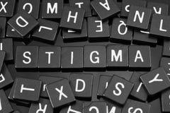 A letra preta telha a soletração da palavra & do x22; stigma& x22; fotografia de stock