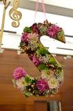 Letra S com flores para dentro Imagens de Stock Royalty Free