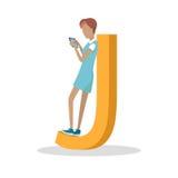 Letra y muchacha de J que se colocan y que juegan en la tableta Imagen de archivo