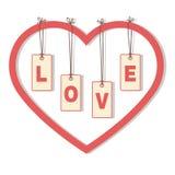 """Letras """"LOVE"""" que penduram dentro do coração Imagem de Stock"""