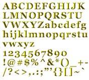 Letras alfabéticas, números e símbolos dourados Fotos de Stock