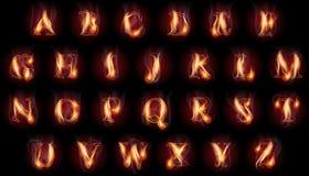 Letras ardentes ajustadas Foto de Stock Royalty Free