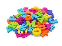 Letras assorted coloridas, no branco Fotografia de Stock Royalty Free