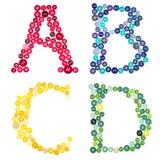 Letras A, B, C, D, hecha fuera de los botones Fotos de archivo