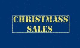 letras blancas de las ventas de la Navidad del sello de goma en un fondo azul Foto de archivo libre de regalías