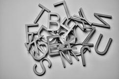 Letras coloreadas texturizadas fondo blanco Fotografía de archivo