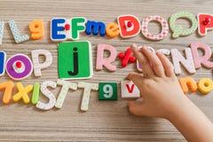 Letras coloridas de diversos materiales Imagen de archivo libre de regalías