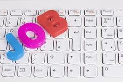Letras coloridas do TRABALHO em um teclado de computador Imagem de Stock