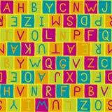 Letras coloridas do whith do teste padrão do fundo Fotografia de Stock