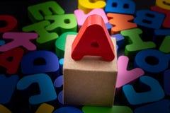 Letras coloridas feitas da madeira foto de stock