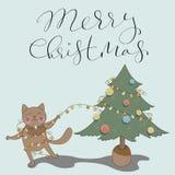 Letras con las tarjetas del día de fiesta de la Feliz Navidad Imágenes de archivo libres de regalías