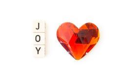 Letras da alegria com o coração vermelho isolado no fundo branco Imagem de Stock