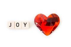 Letras da alegria com o coração vermelho isolado no fundo branco Imagem de Stock Royalty Free