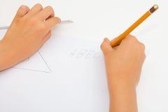 Letras da escrita da menina Imagens de Stock
