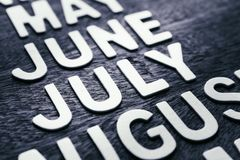 Letras da madeira de julho Imagem de Stock