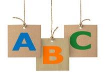 Letras de ABC en etiqueta de la cartulina Logotipo del alfabeto aislado Imagen de archivo