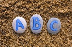 Letras de ABC en piedras Foto de archivo libre de regalías