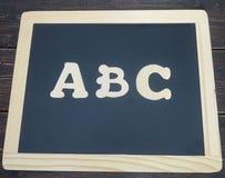 Letras de ABC en una pizarra Imágenes de archivo libres de regalías