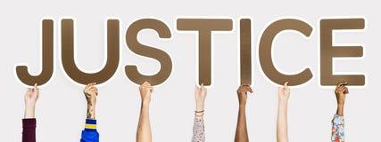 Letras de Brown que formam justiça da palavra imagens de stock royalty free