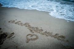 Letras de la arena en la playa Fotografía de archivo