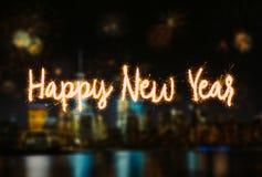 Letras de la escritura de la Feliz Año Nuevo con el fondo borroso Imágenes de archivo libres de regalías